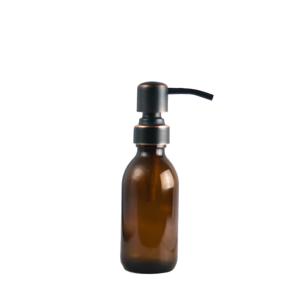 Kleine herbruikbare glazen fles met metalen pompje